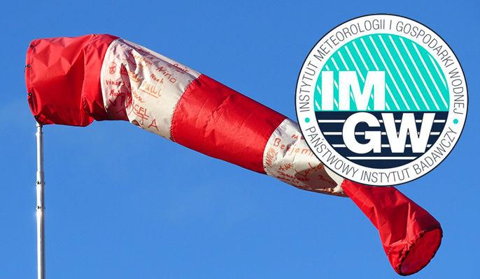 Grafika ogólna - logo IMGiW na tle zdjęcia rękawa lotniskowego