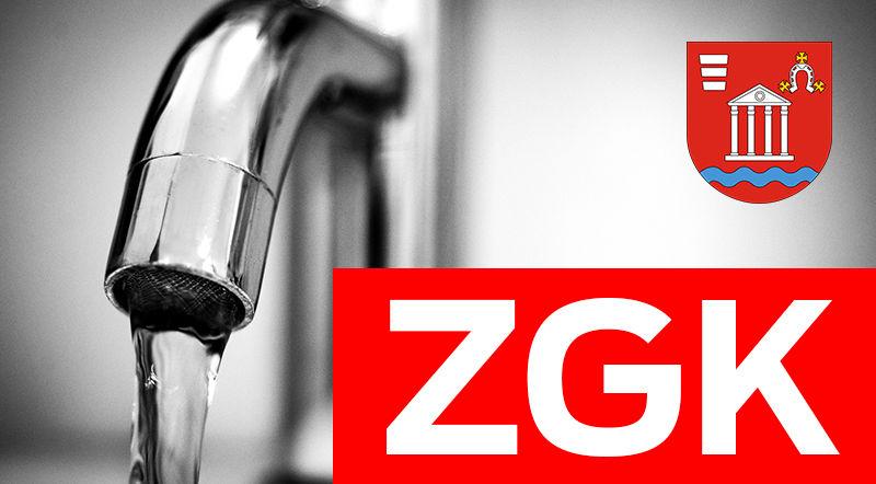 Napis ZGK i herb gminy na tle kranu
