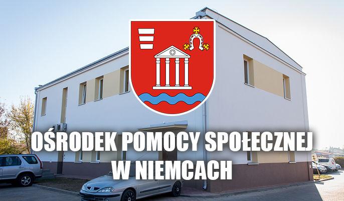 Na zdjęciu budynek Ośrodka Pomocy Społecznej na środku herb gminy.