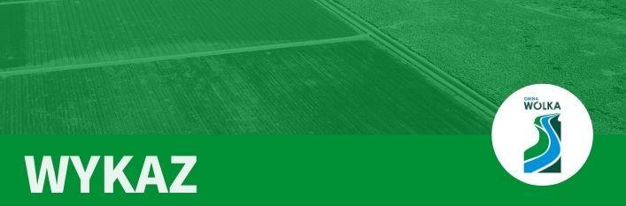 Napis na zielonym tle - wykaz z logo Gminy Wólka
