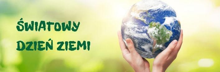 Planeta w dłoniach i napis Światowy Dzień ziemi