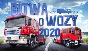 Grafika Dwa wozy strażackie i napis Bitwa o Wozy