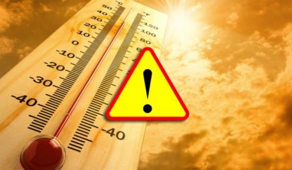 termometr wskazujący wysoką temperaturę oraz znak ostrzeżenia