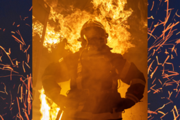 Grafika przedstawia strażaka w ogniu