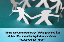 """Grafika przedstawia papierowe postacie oraz napis  Instrumenty Wsparcia dla Przedsiębiorców """"COVID-19"""""""