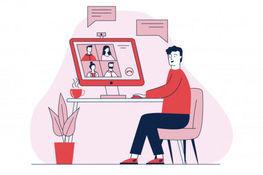 Grafika przedstawia mężczyznę siedzącego przy biurku,  na którym stoi laptop