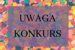 Konfetti a na nim napis UWAGA KONKURS