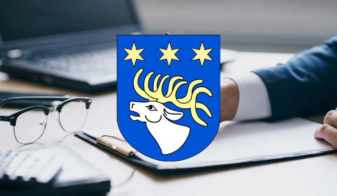 Herb powiatu ryckiego na tle osoby podpisującej dokument