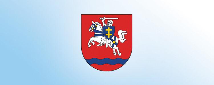 Herb powiatu puławskiego na błękitnym tle.