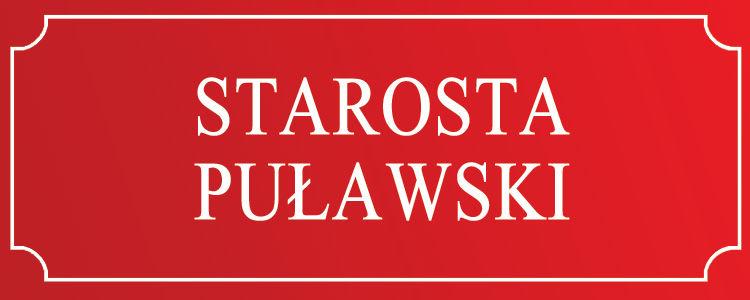 Starosta Puławski - białe litery na czerwonym tle, biała, ozdobna obwódka