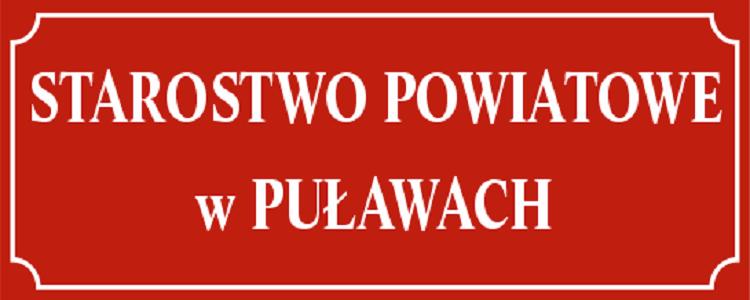Starostwo Powiatowe w Puławach , białe litery na czerwonym tle w ozdobnej ramce