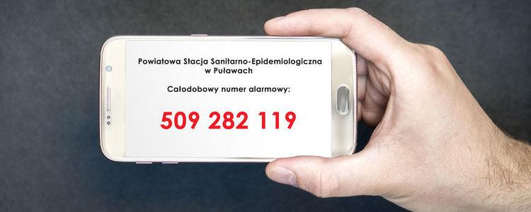 Telefon komórkowy z numerem telefonu do puławskiej stacji SANEPID.