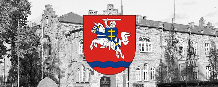 Grafika przedstawia herb powiatu. W drugim planie widoczny budynek Starostwa Powiatowego w Puławach.