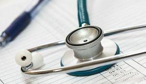 Grafika przedstawiająca stetoskop i zeszyt