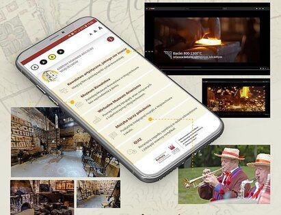 aplikacja: telefon z aplikacja na tle atrakcji regionu