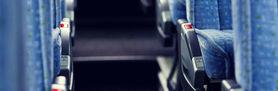 Grafika przedstawia siedzenia w autobsie