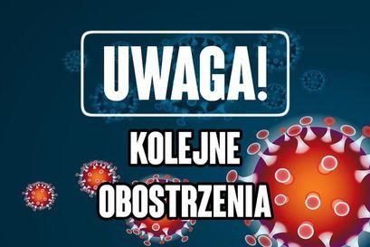 Napis UWAGA! Kolejne obostrzenia w tle wirus