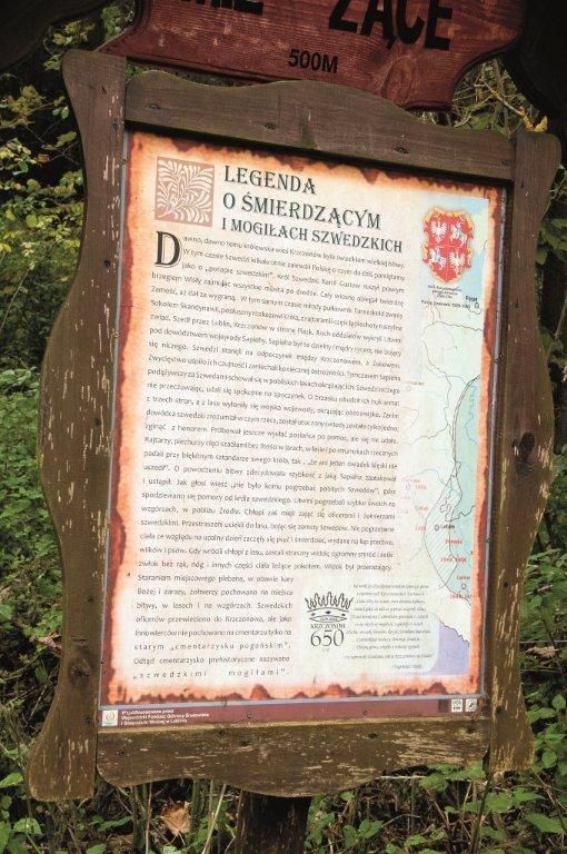 Grafika przedstawia tablice z Legendą o śmierdzącym i mogiłach szewdzkich