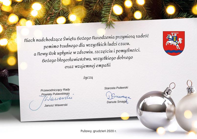 Grafika świąteczna i życzenia: Niech nadchodzące Święta Bożego Narodzenia przyniosą radość pomimo trudnego dla wszystkich ludzi czasu, a Nowy Rok upłynie w zdrowiu, szczęściu i pomyślności. Bożego błogosławieństwa, wszystkiego dobrego oraz wzajemnej empatii  życzą  Przewodniczący Rady Powiatu Janusz Wawerski Starosta Puławski Danuta Smaga  Puławy, grudzień 2020 r.